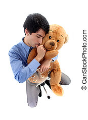 A businessman hugging a teddy bear.