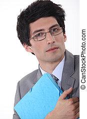 A businessman hugging his folder.