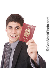 A businessman in a suit holds passport - A businessman in a...