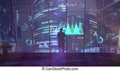A businessman is looking at infographic financial data.