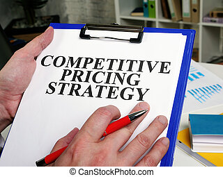 A Businessman reads competitive pricing strategy report.