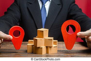 A businessman sets a destination for goods delivery. Global ...