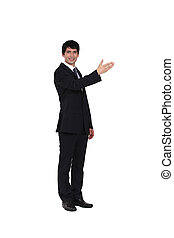 A businessman showing directions.