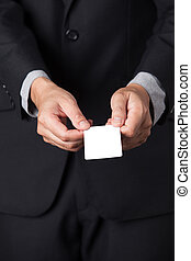A Businessman showing his name card.