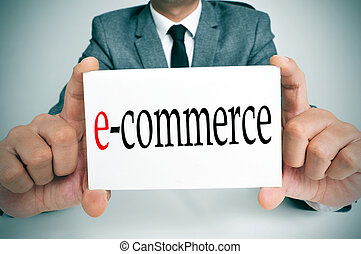 e-commerce - a businessman sitting in a desk holding a...