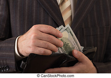 A businessman takes out money from his wallet. Close-up