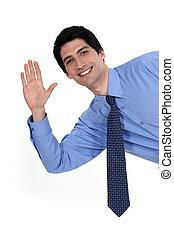 A businessman waving.