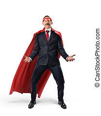 A businessman wearing superman cape and mask trying to lift up an invisible object from below.