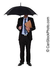 A businessman with an umbrella.