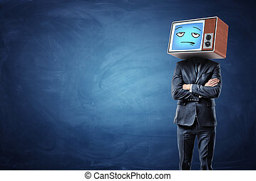 A businessman with folded hands and an old TV on his head showing a blue bored emoticon.