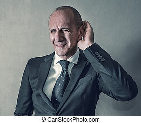 Businessman with hearing problems