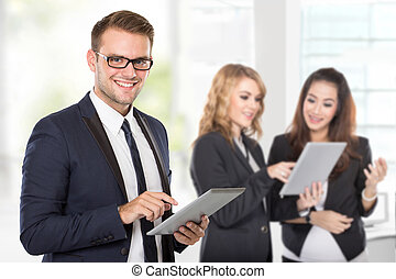 A businessman with his colleague using tablet pc