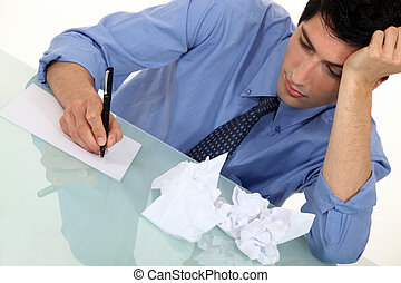A businessman writing.