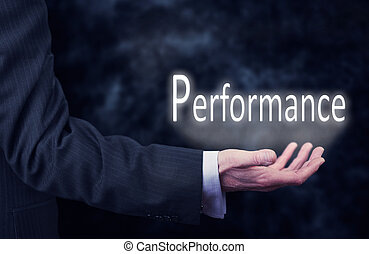 Performance - A businessmans hand holding the word,...