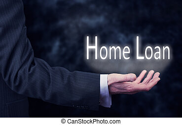 Home Loan - A businessmans hand holding the words, Home...