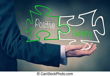 Positive Thinking - A Businessmans hand holding the words...