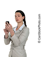 A businesswoman checking her Smartphone.