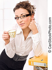 A businesswoman drinking coffee, thinking