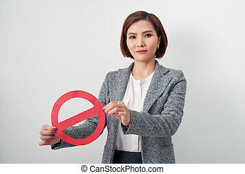 A businesswoman holding a with stop symbol isolated on white background