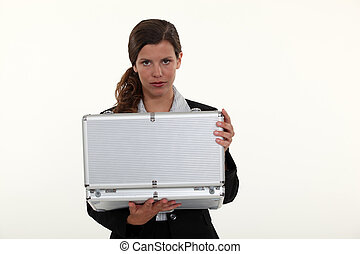 A businesswoman looking in her briefcase.