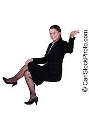 A businesswoman making a gesture.