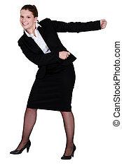 A businesswoman miming.