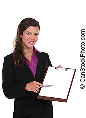 A businesswoman presenting a clipboard.