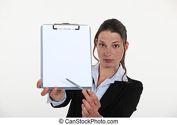 A businesswoman presenting a contract.