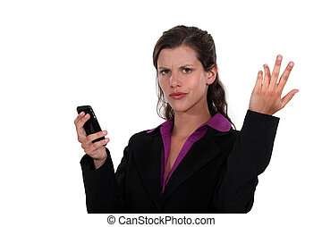 A businesswoman receiving bas news.