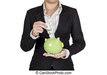 a businesswoman saving money