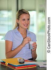 A businesswoman taking a coffee break.