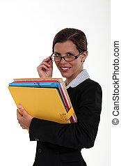 A businesswoman with a big folder.