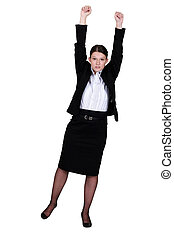 A businesswoman with her two fists up.