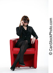 A businesswoman with sunglasses on.