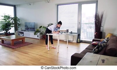 A businesswoman working in home office.