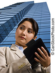 A Businesswoman Writing in a Personal Organizer