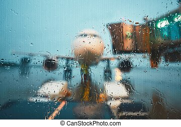 A busy airport in the rain