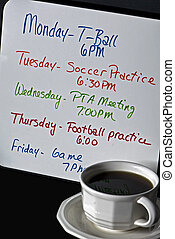 A Busy Week - Weeks schedule written on dry erase board with...