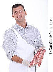 a butcher showing pork ribs