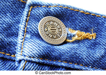 A button on the old blue jeans