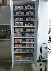 a cabinet full of surgical instruments Container