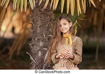 A Caicasian girl with coconut processing in the Mekong Delta Ben Tre, Vietnam