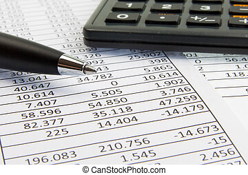 calculator and pen on financial papers