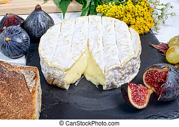 Camembert cheese on a plate slate