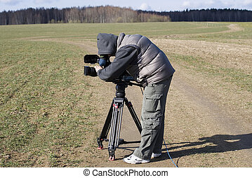 A cameraman is shooting a film