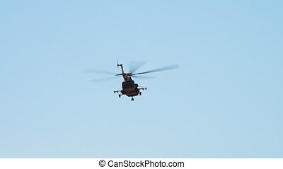 A camouflage chopper - A tracking shot of a flying transport...