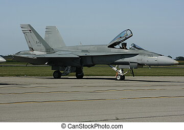 Canadian Airforce - A Canadian Airforce jet on a tarmac in...