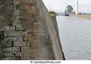 A canal with water for seaworthy ships calling. Stone historical ancient walls.