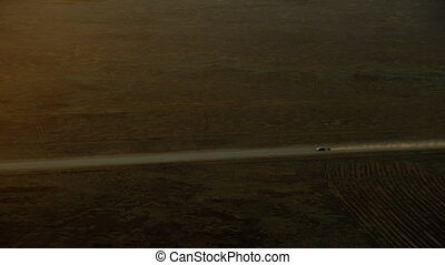 A car going highspeed on a desert highway - A slow motion...