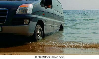 A car in the sea